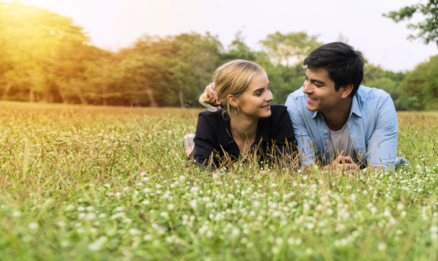 Couple talking in the grass
